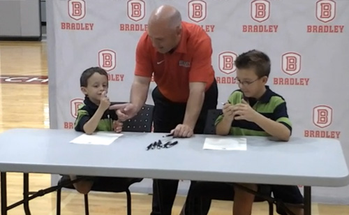 Basketball Team Signs 5-year-old with Brain Tumor