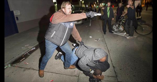 Undercover Cop Draws Gun On Oakland Protestors – PHOTOS