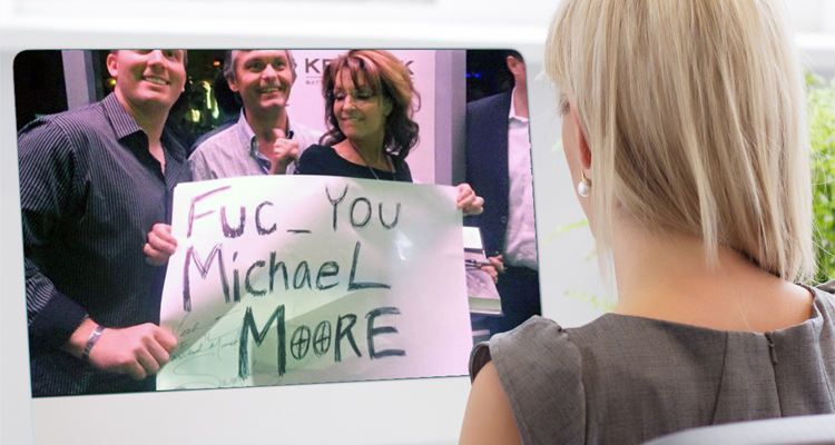 Sarah Palin Poses With 'Fuc_ You Michael Moore' Crosshairs Sign At Gunshow