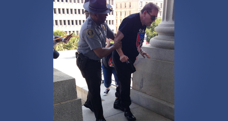 Officer/Dir. Leroy Smith Comments On Viral Photo Taken Of Him At KKK Rally