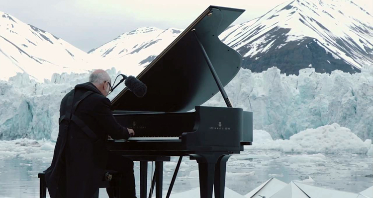 Glacier Collapses Right Behind Him As He's Floating, Playing A Grand Piano In The Arctic – Video