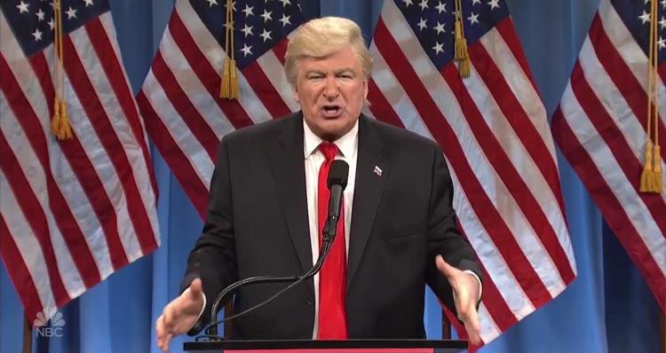 Alec Baldwin Returns To SNL To Talk 'Golden Showers' – Video