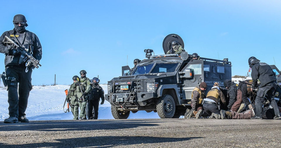 Heavily Militarized Police Raid Results In 76 Arrests At Standing Rock – Video